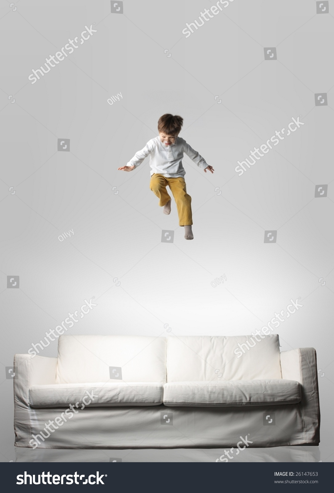 Child Jumping On A Sofa Stock Photo 26147653 Shutterstock