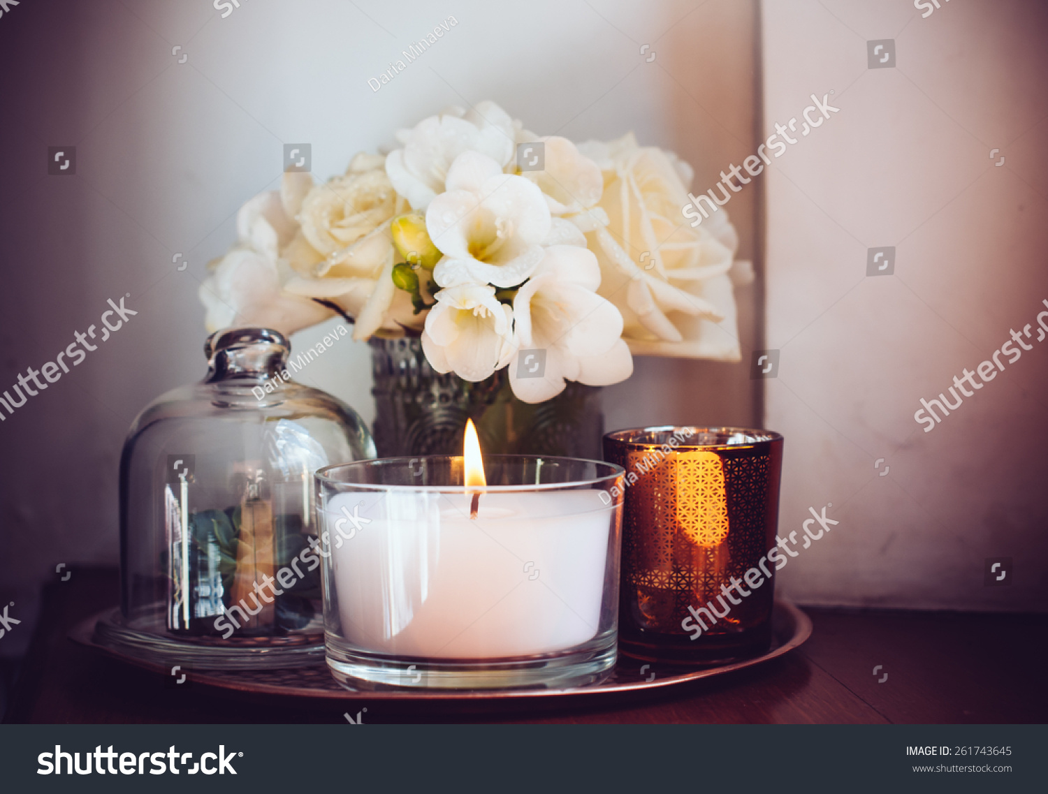 bouquet of white flowers in a vase candles on vintage copper tray wedding home - Candles Home Decor