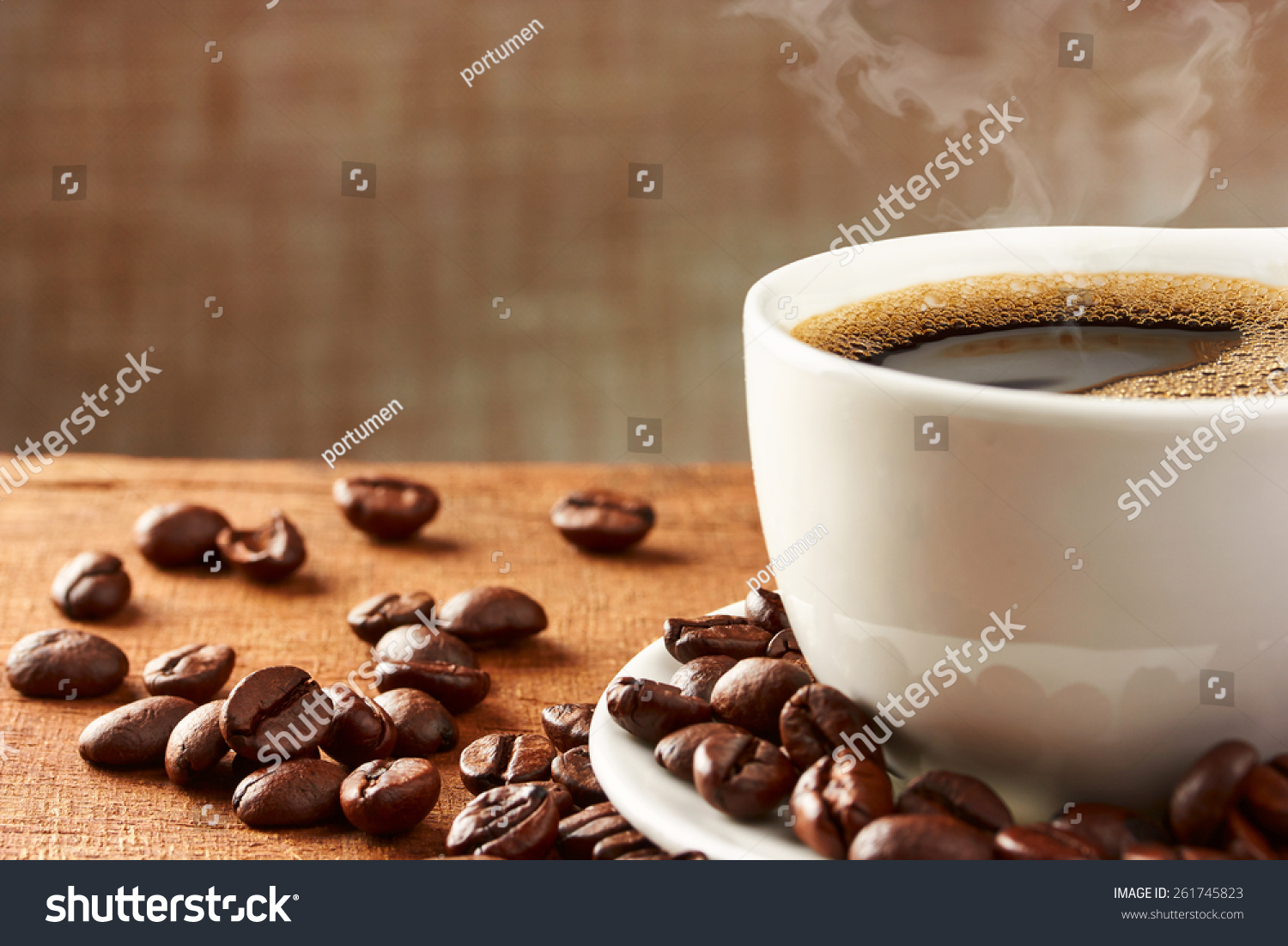 Coffee cup coffee beans on table stock photo 261745823 shutterstock coffee cup and coffee beans on table geotapseo Gallery