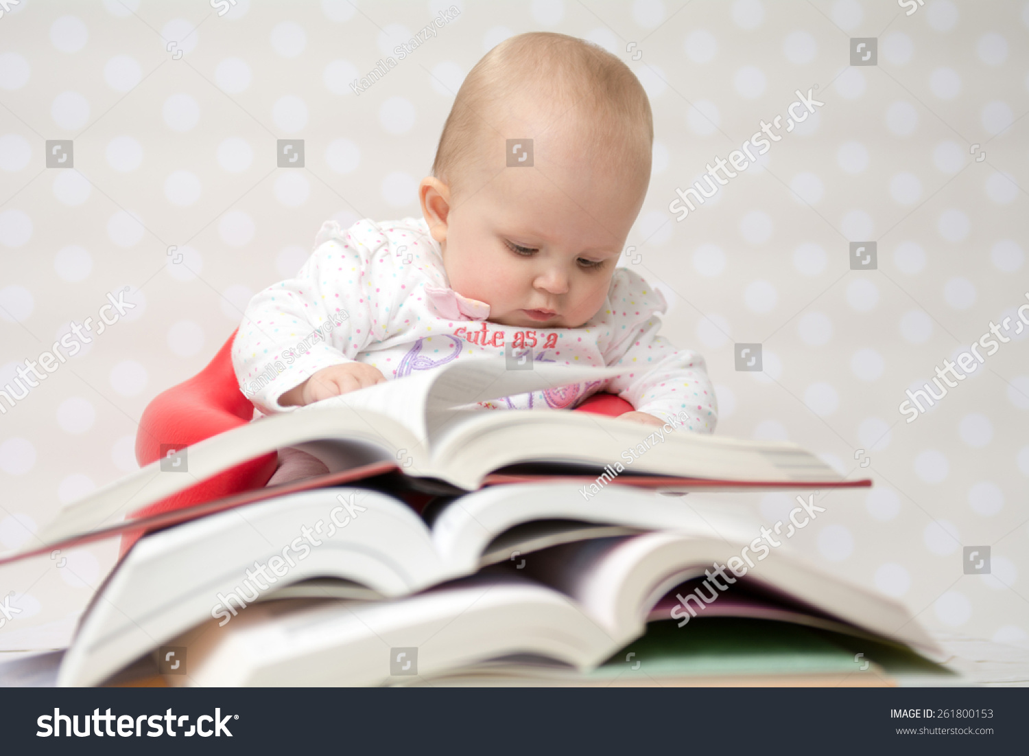 cute baby girl reading behind pile stock photo (edit now) 261800153