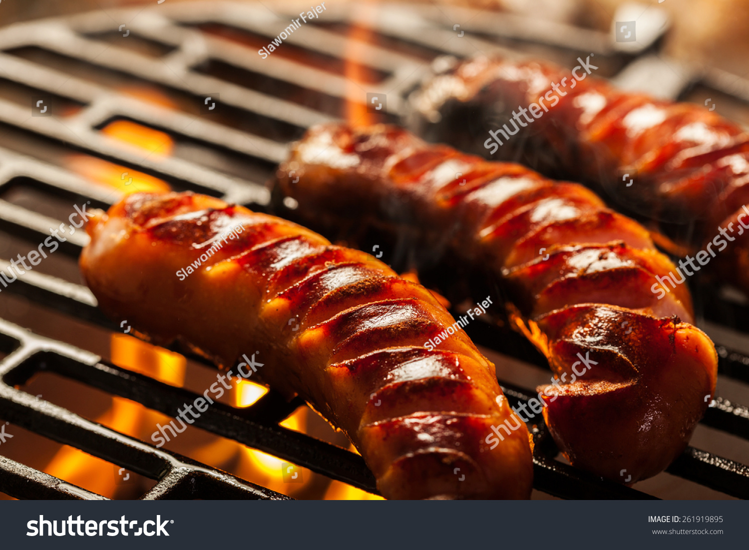 grilling sausages on barbecue grill selective stock photo. Black Bedroom Furniture Sets. Home Design Ideas