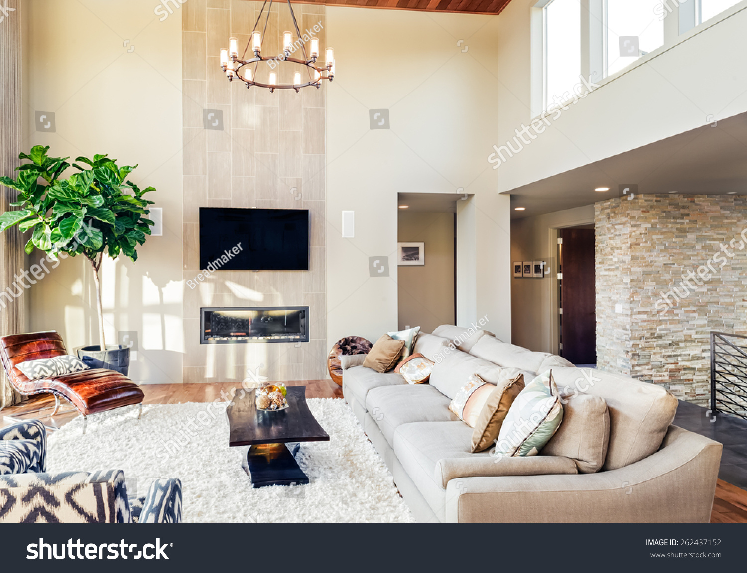 Beautiful Living Room With Hardwood Floors Tv Chandelier And Fireplace