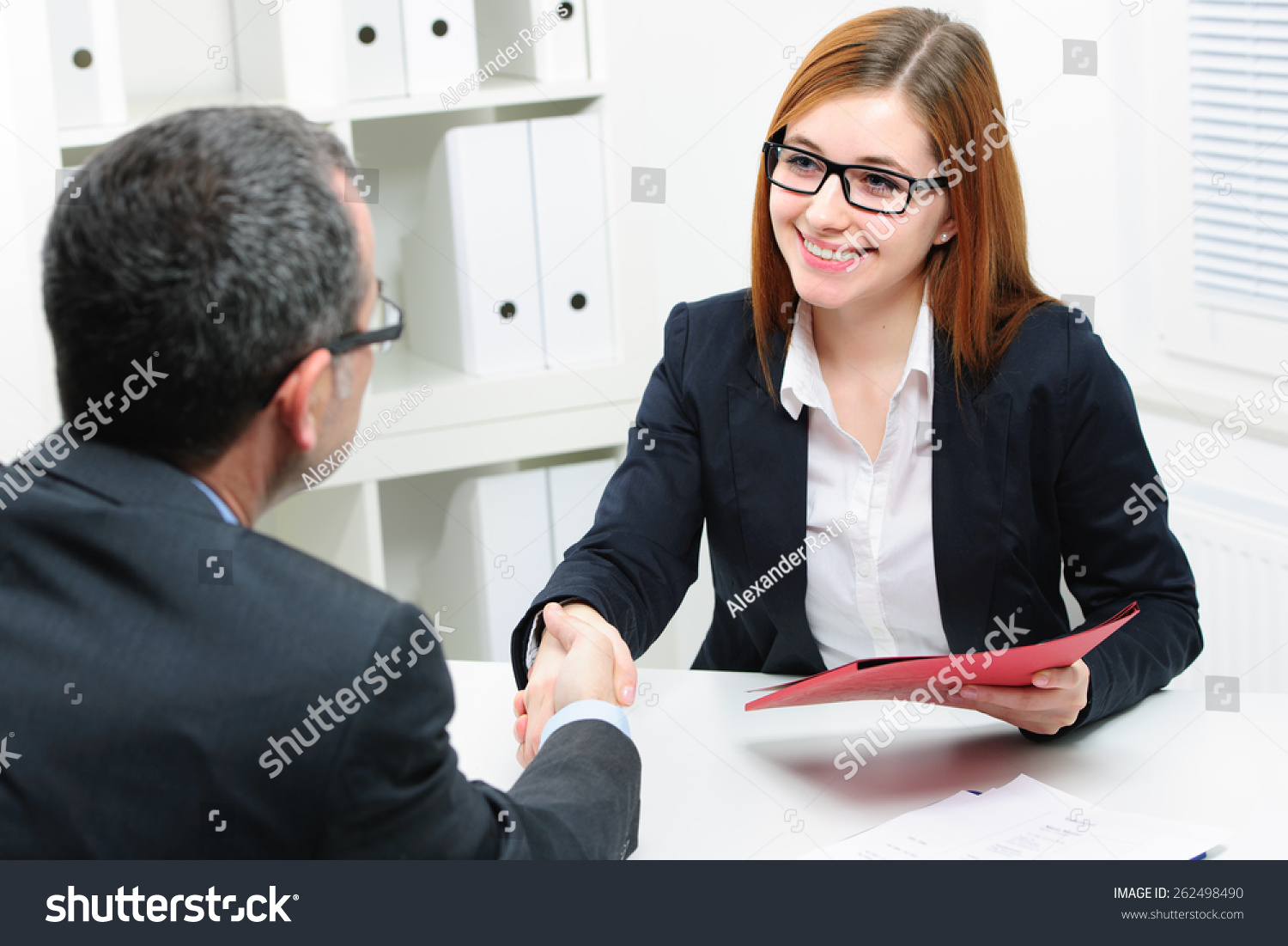 job applicant having interview handshake while stock photo job applicant having interview handshake while job interviewing