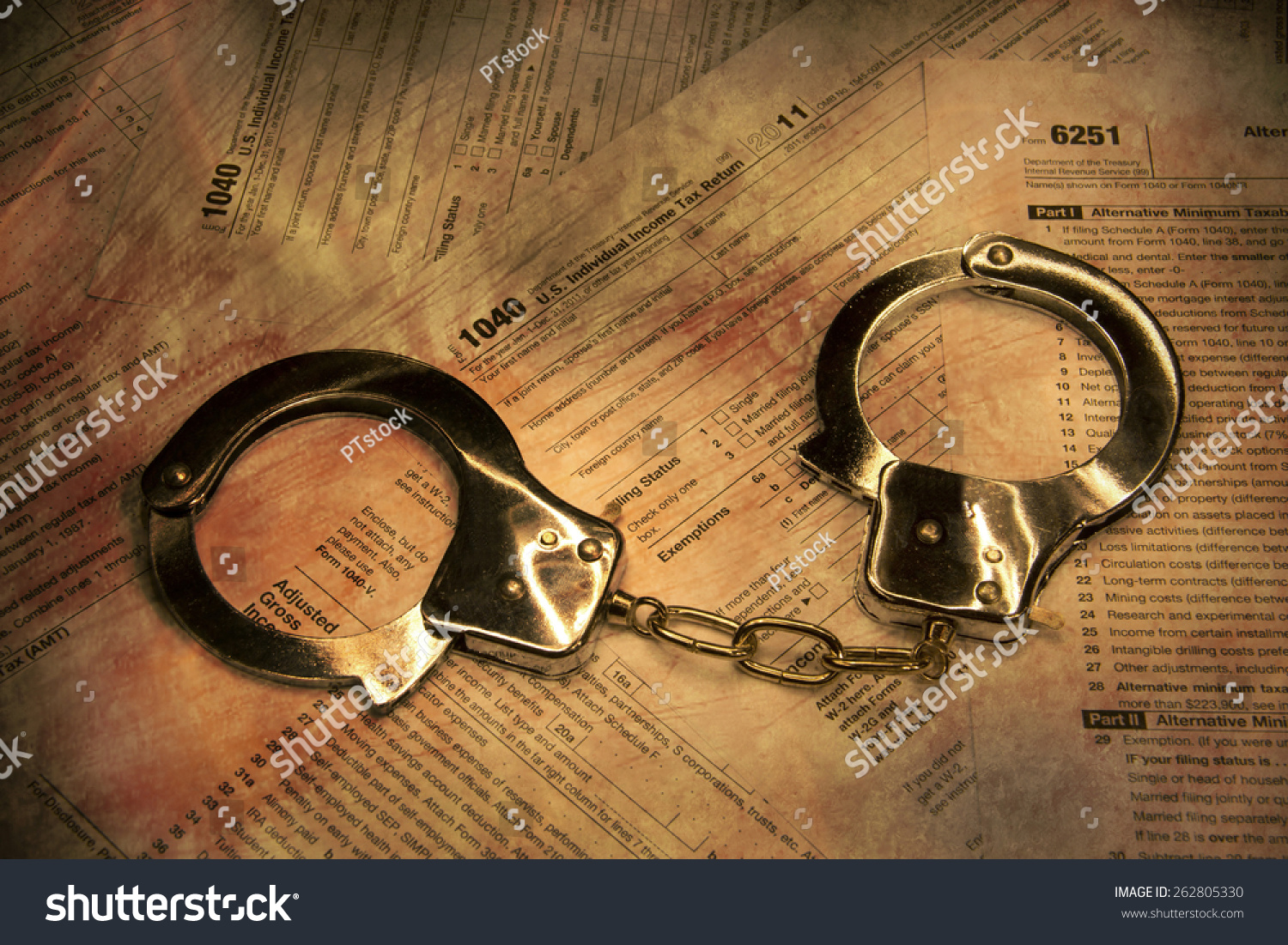 Handcuffs on form 1040 federal tax stock photo 262805330 shutterstock falaconquin