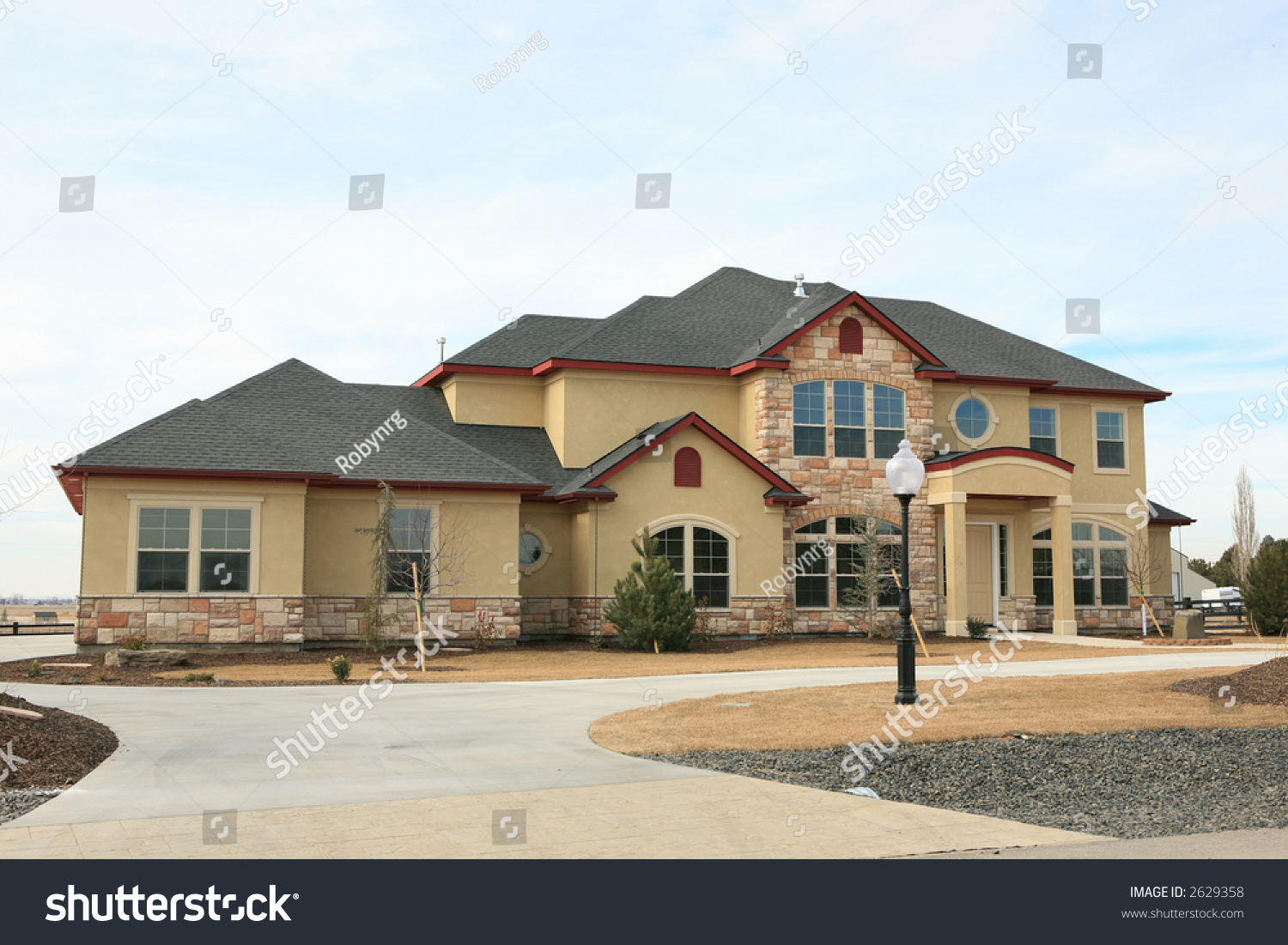 Large expensive modern house yellow stucco and stone stock for Modern house yellow