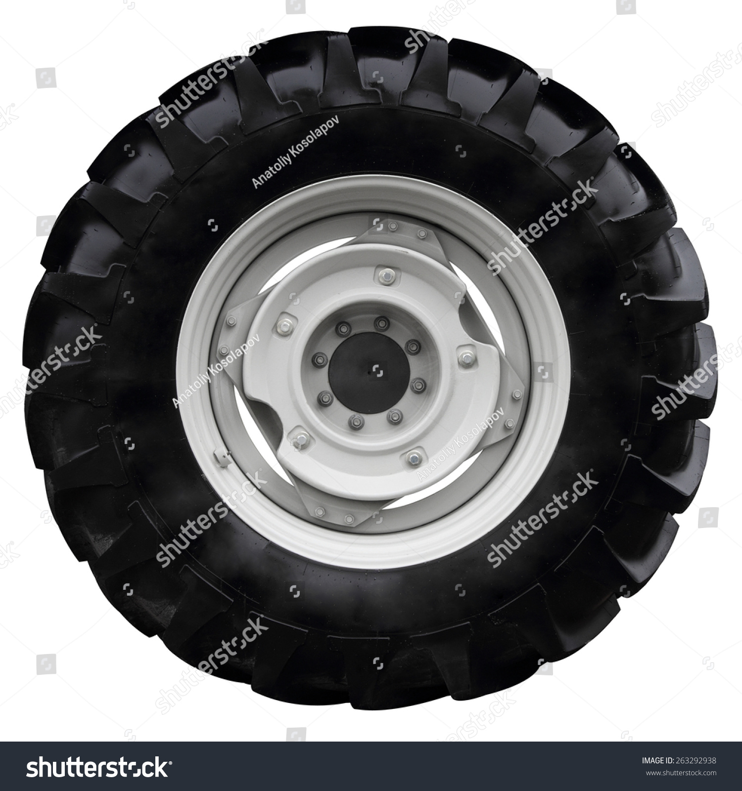 White Tractor Rims : The black wheel tractor isolated on white background stock