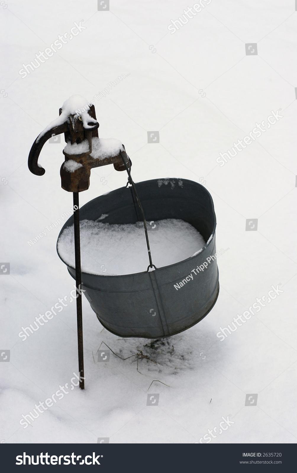 Antique Spigot Bucket Snow Hanging Over Stock Photo & Image (Royalty ...