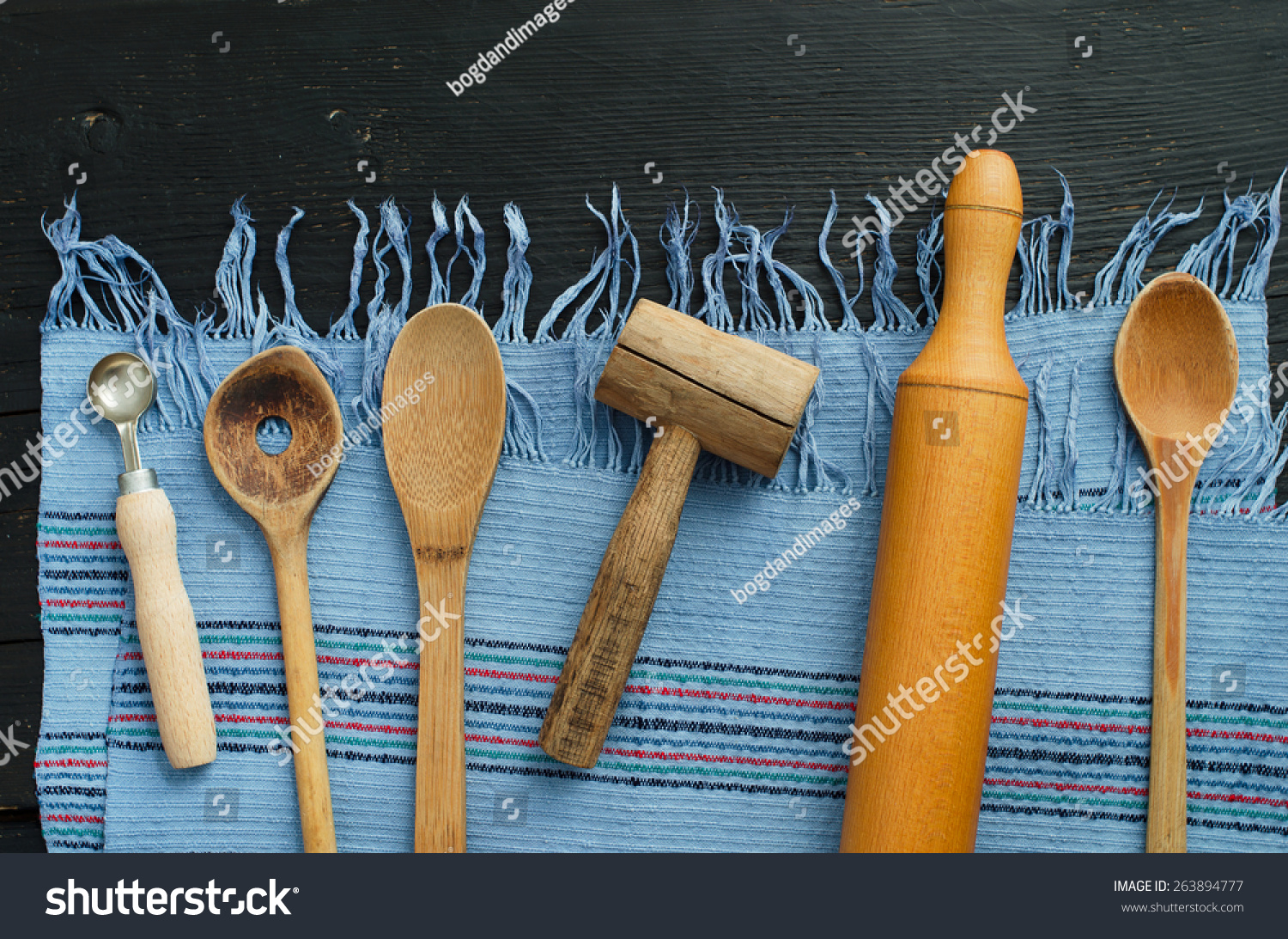 Set of various kitchen tools on old wooden table, top view. Wooden ...