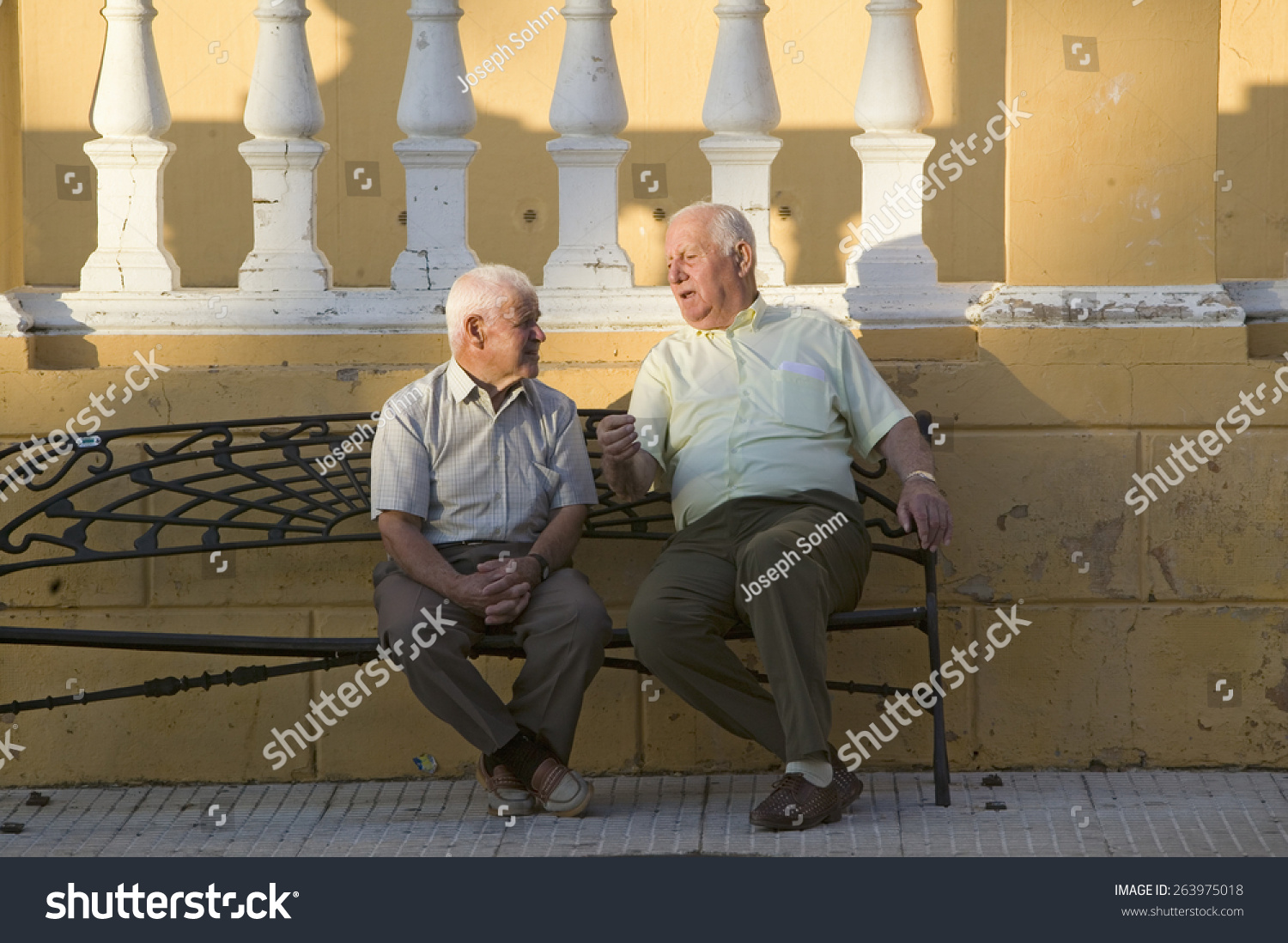 Two Older Men Talk On Bench Stock Photo Edit Now 263975018