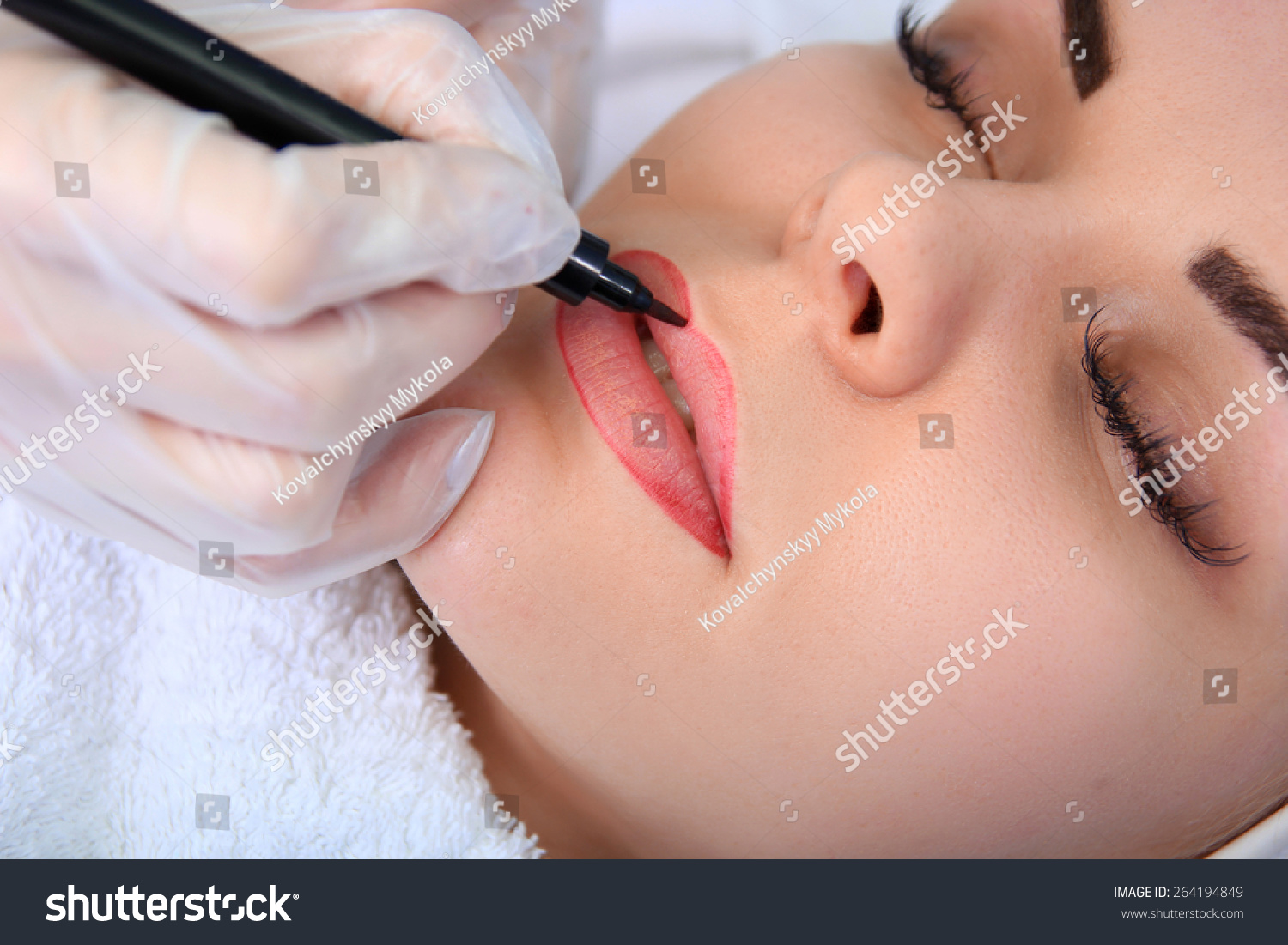 Young beautiful woman having permanent make-up Tattoo
