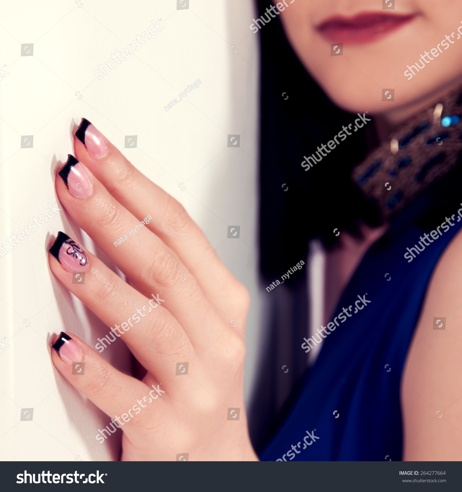 Nail Polish For Dark Hands: Woman'S Hand With Pink And Black Gel Nail Polish Stock