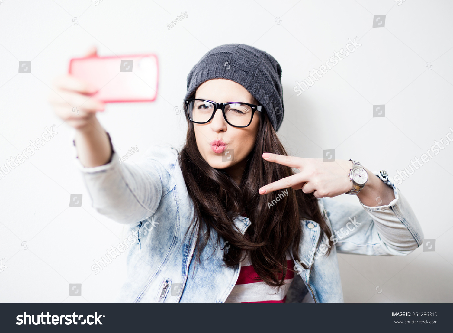 pretty hipster girl taking selfie making stock photo