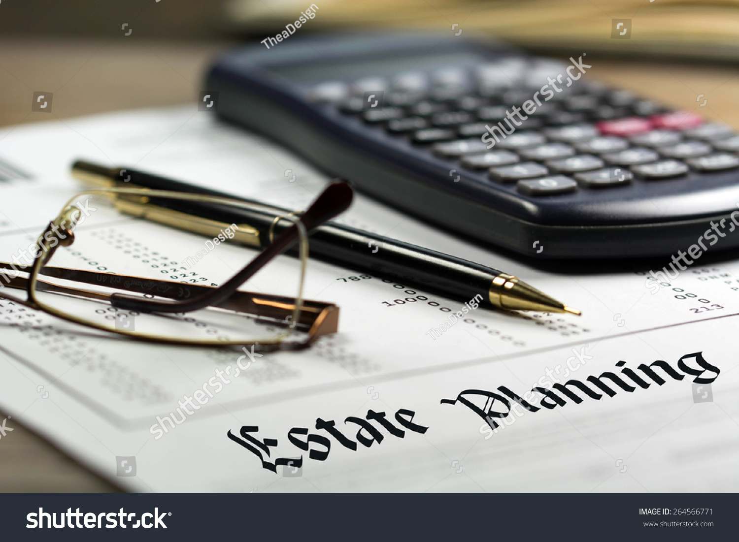 Estate planning. Calculator, glasses and black pen on financial.