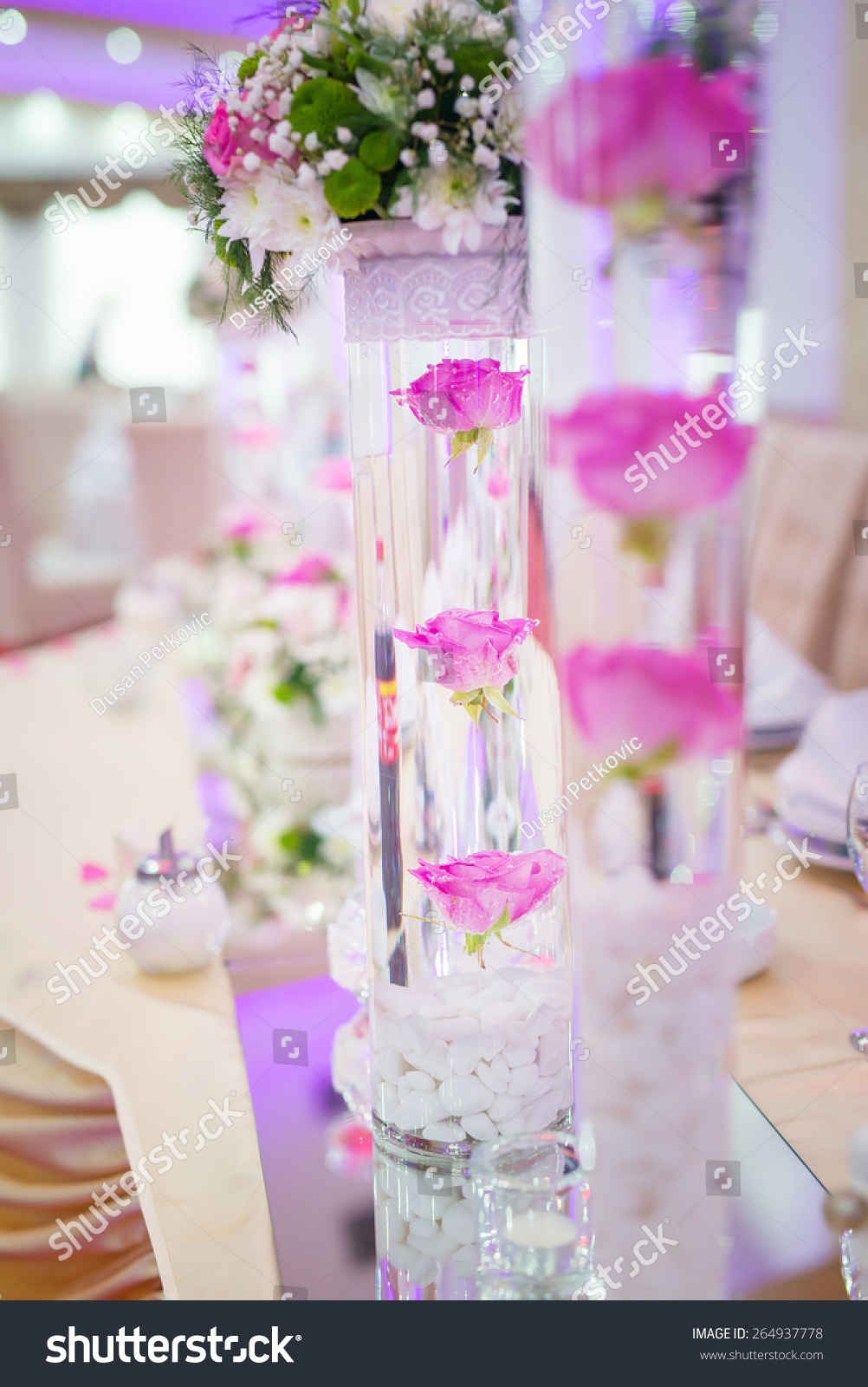 Table setting at a luxury wedding decorated with composition of ...
