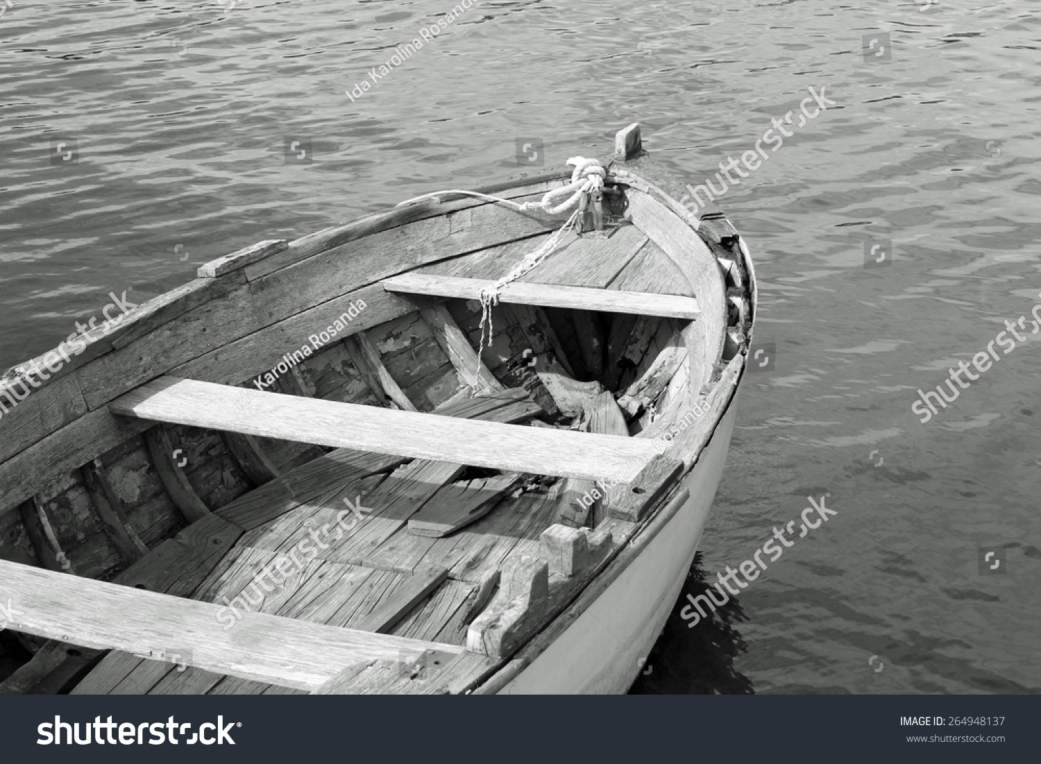 old wooden boat in black and white stock photo 264948137
