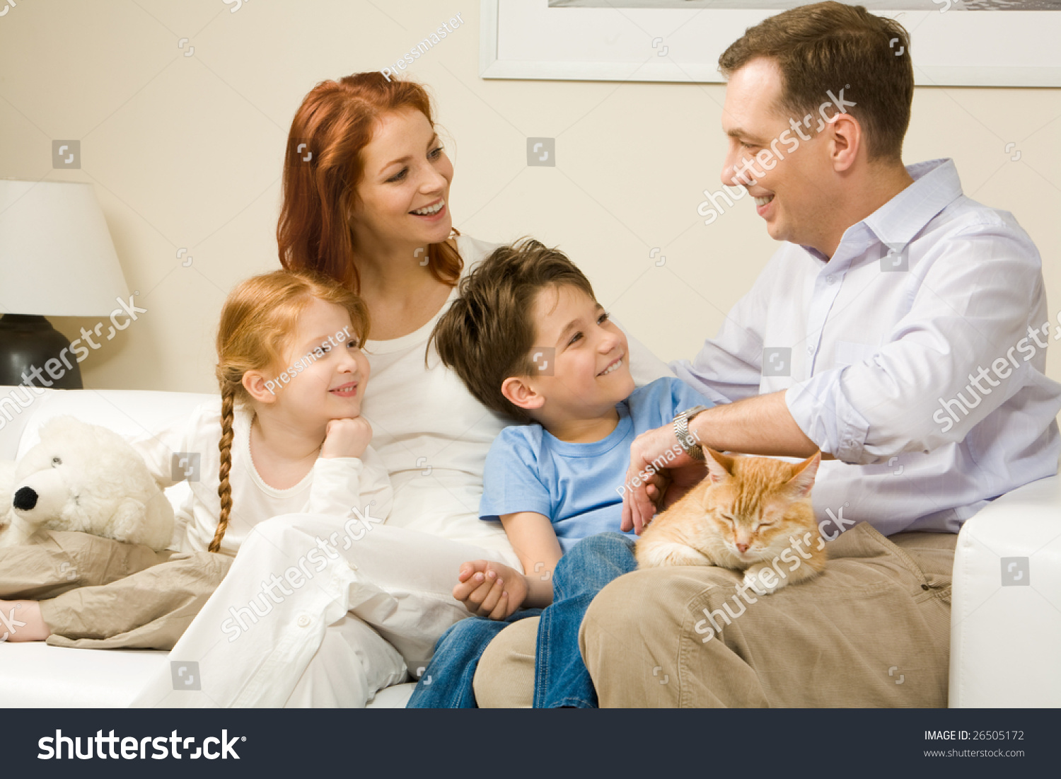 Friendly family members sitting on comfortable sofa and for Comfortable family sofa