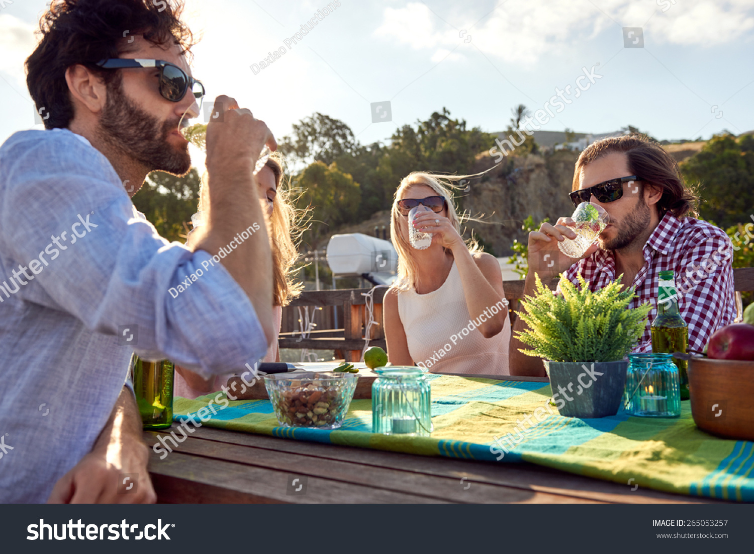 Group friends sitting hanging out drinks stock photo for Hanging groups of pictures