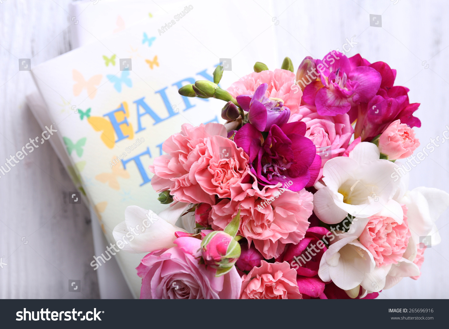 Beautiful Fresh Spring Flowers With Stack Of Books Top View Ez Canvas