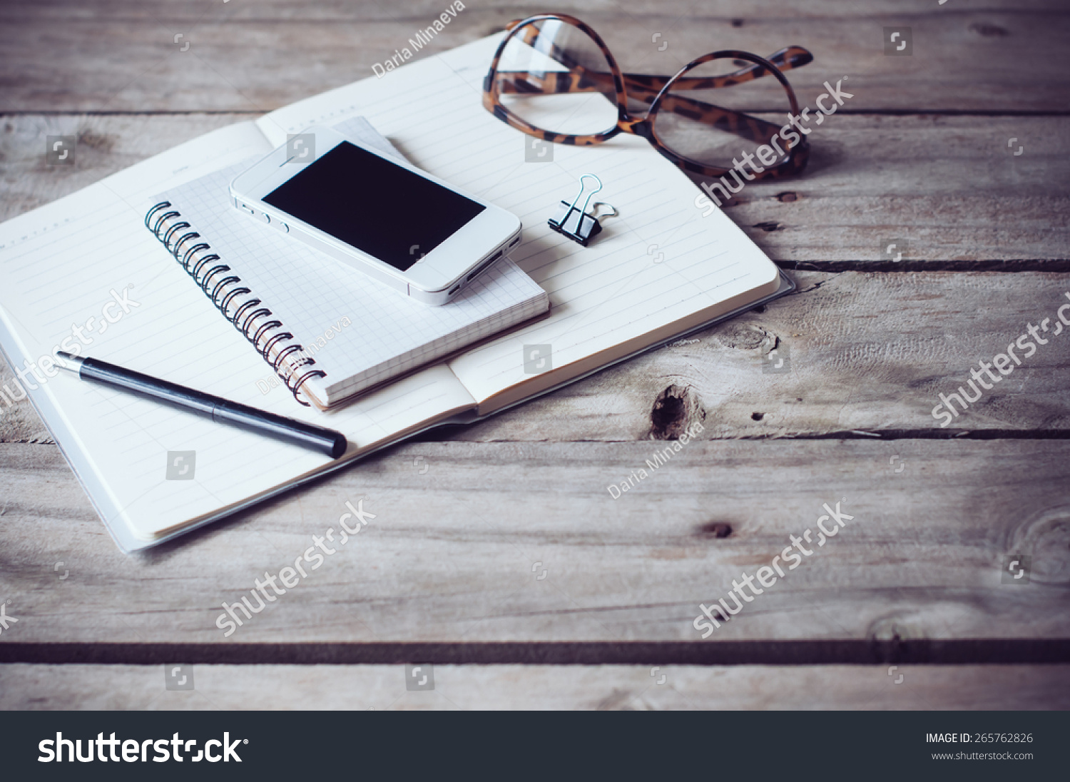 Hipster Home Office Tabletop: Papers And Notebooks, Reading Glasses, Smart  Phone, Pen