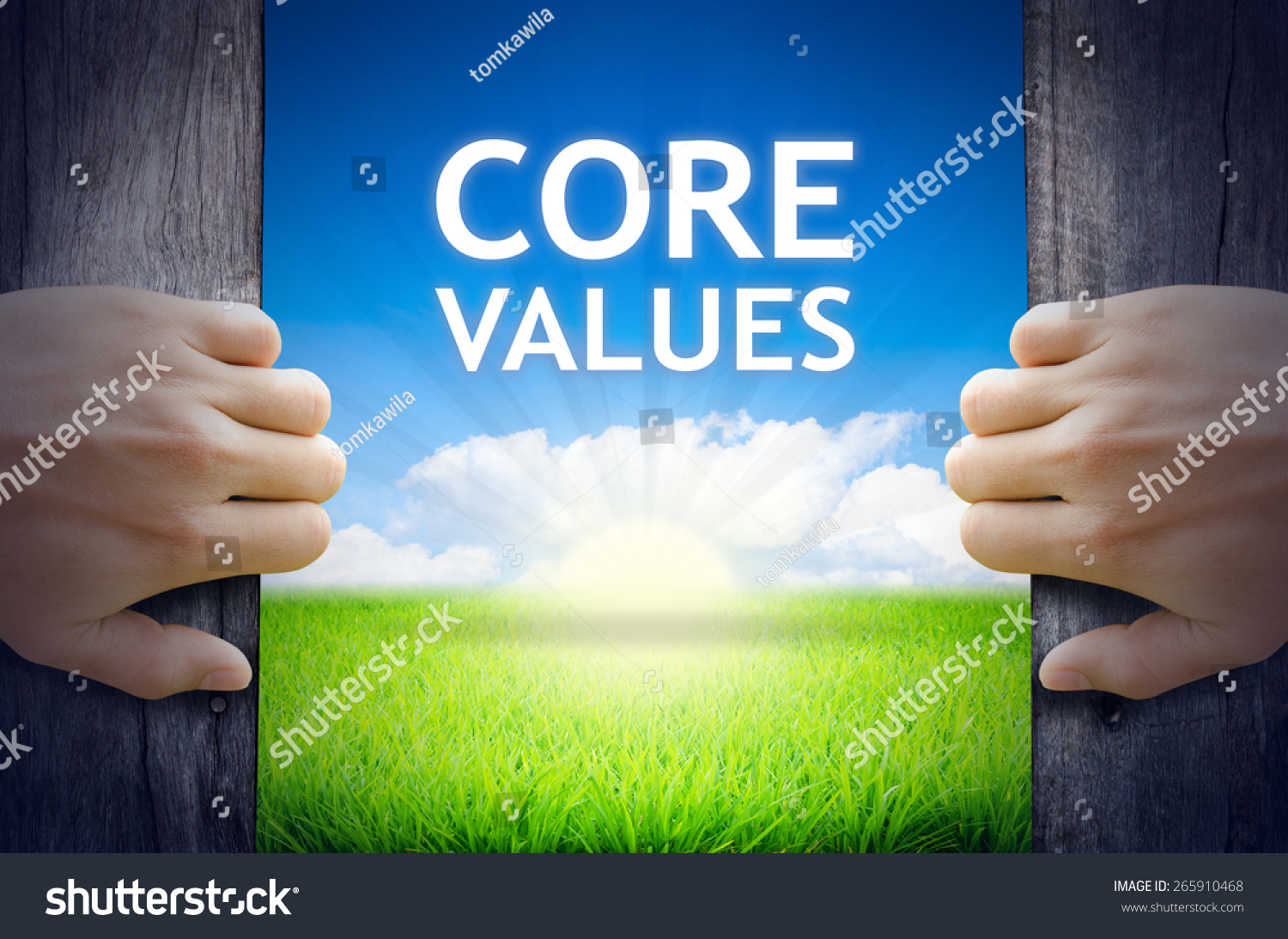 Core Values Hands opening a wooden door then found a texts floating among new world as green grass field Blue sky and the Sunrise