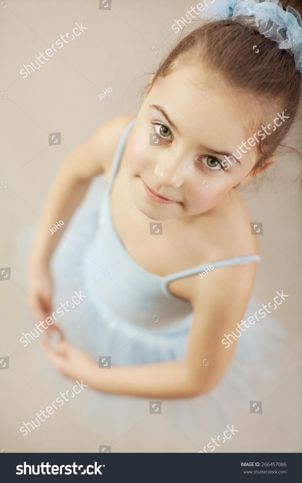 c7ce534253d36b Adorable little ballerina dancer posing in ballet studio. She is wearing  blue leotard and tutu