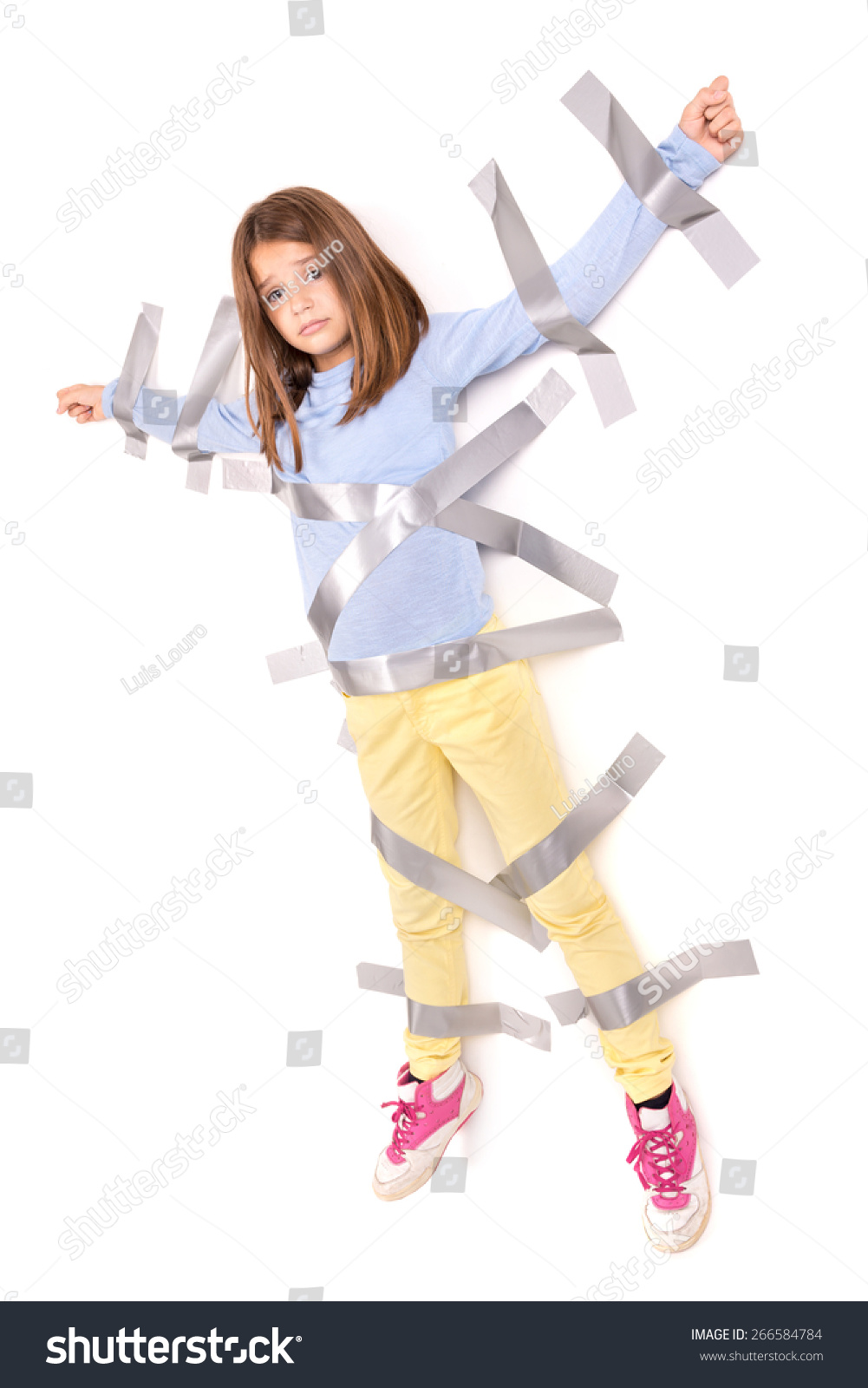 young girls tied up Young girl tied to the wall with duct tape