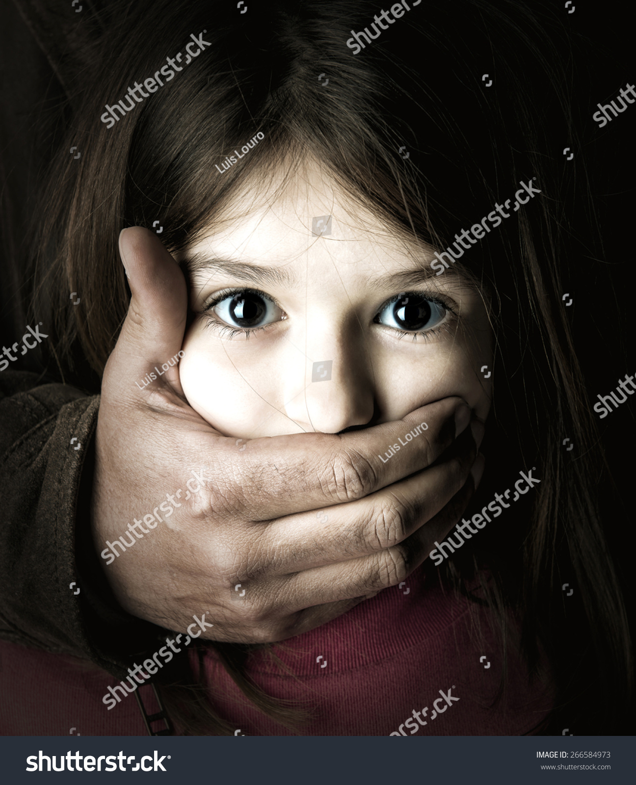 scared young girl adult mans hand stock photo 266584973