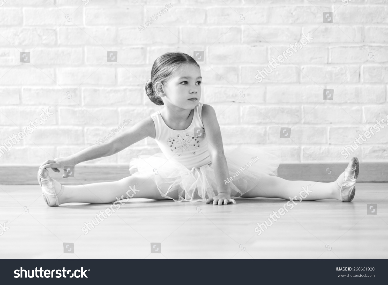 Young ballerina white clothes sitting on stock photo for Dance where you sit on the floor