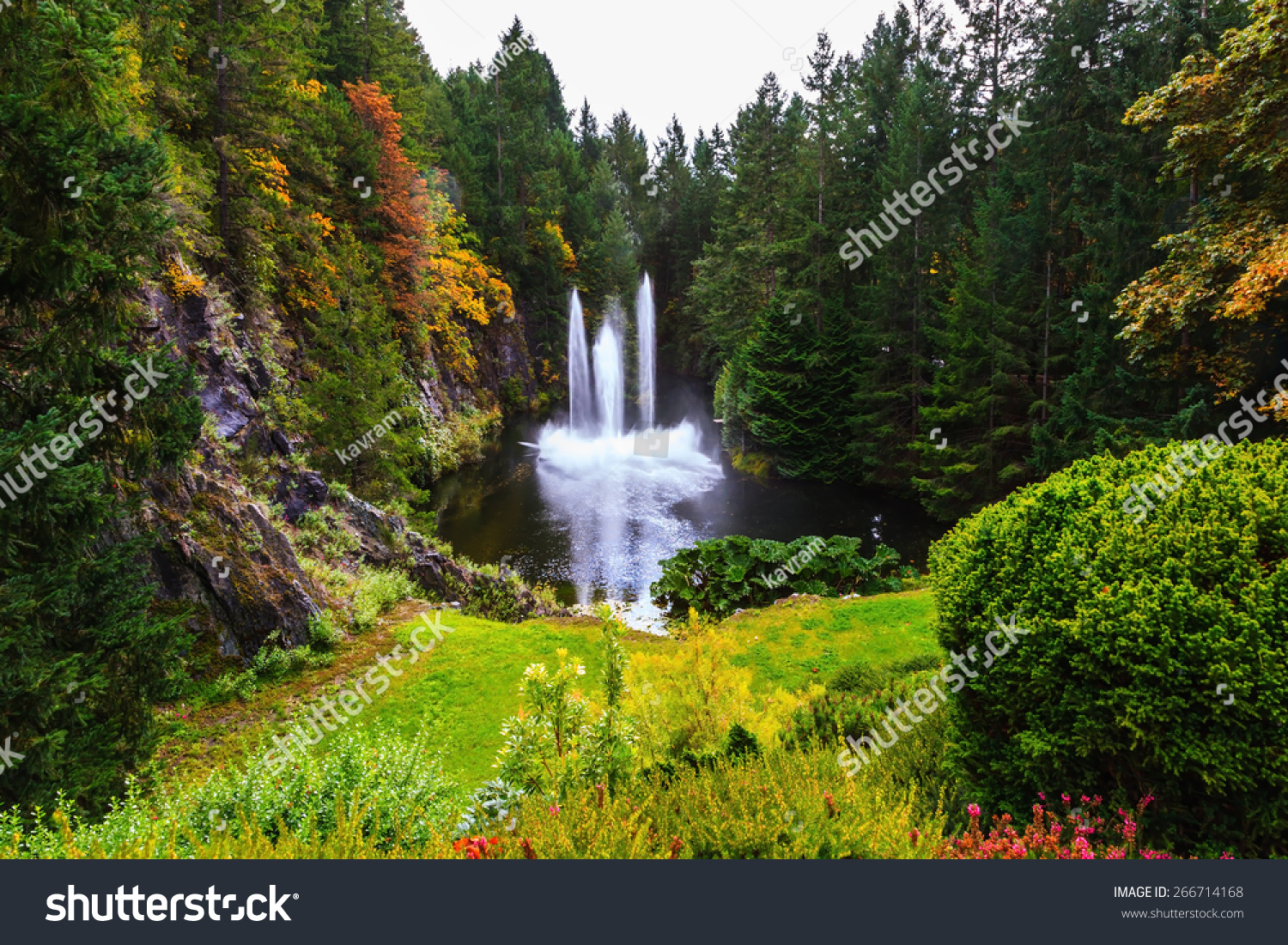 Butchart Gardens On Vancouver Island Canada Dancing Fountain In A Quiet Pond Autumn Day In