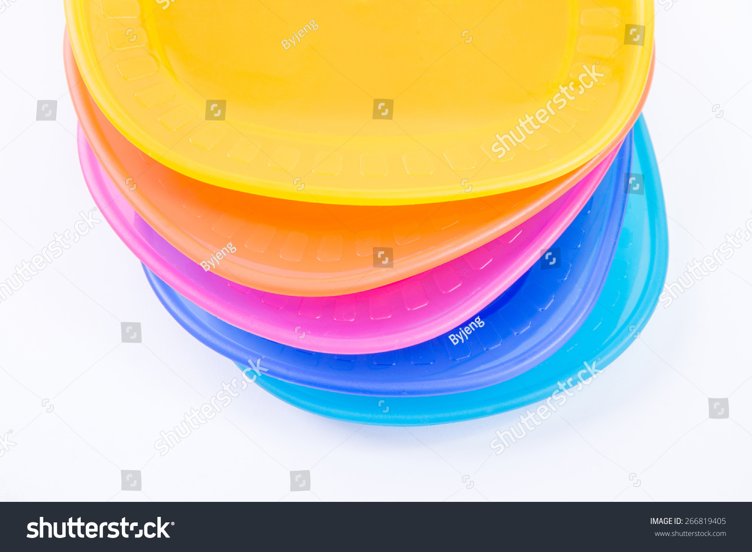 Colorful plastic plates closeup isolated on white background & Colorful Plastic Plates Closeup Isolated On Stock Photo 266819405 ...