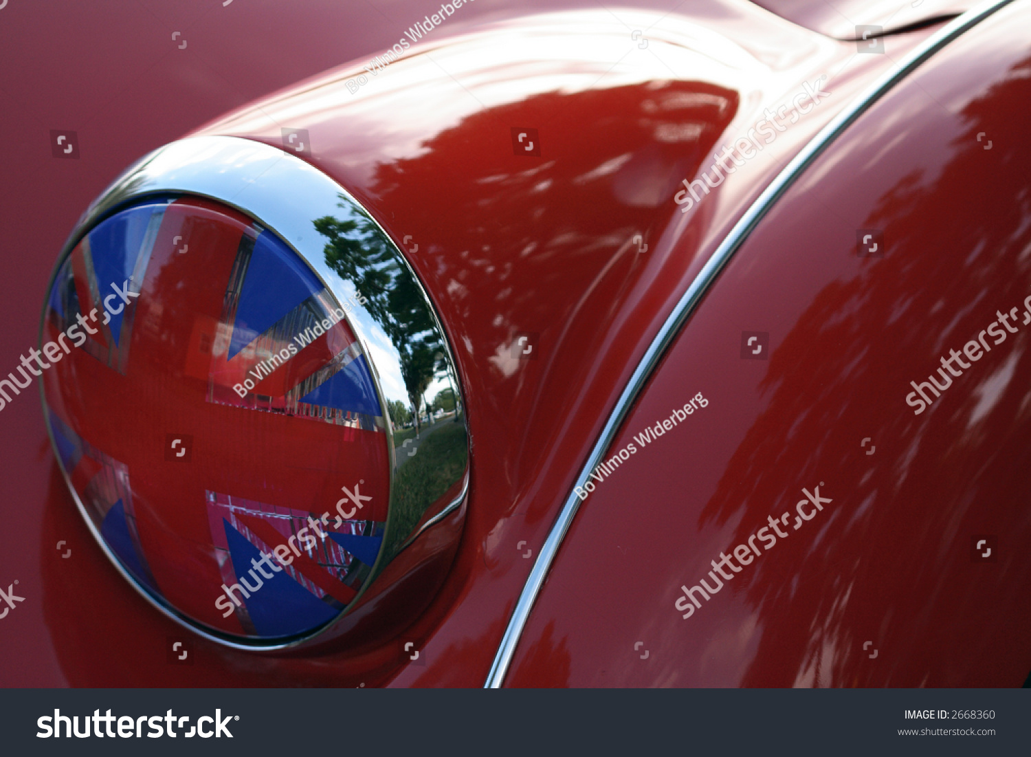 detail of flag headlight cover on vintage british race car. Black Bedroom Furniture Sets. Home Design Ideas