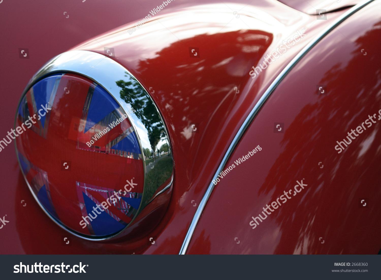 detail of flag headlight cover on vintage british race car. Black Bedroom Furniture Sets. Home Design Ideas
