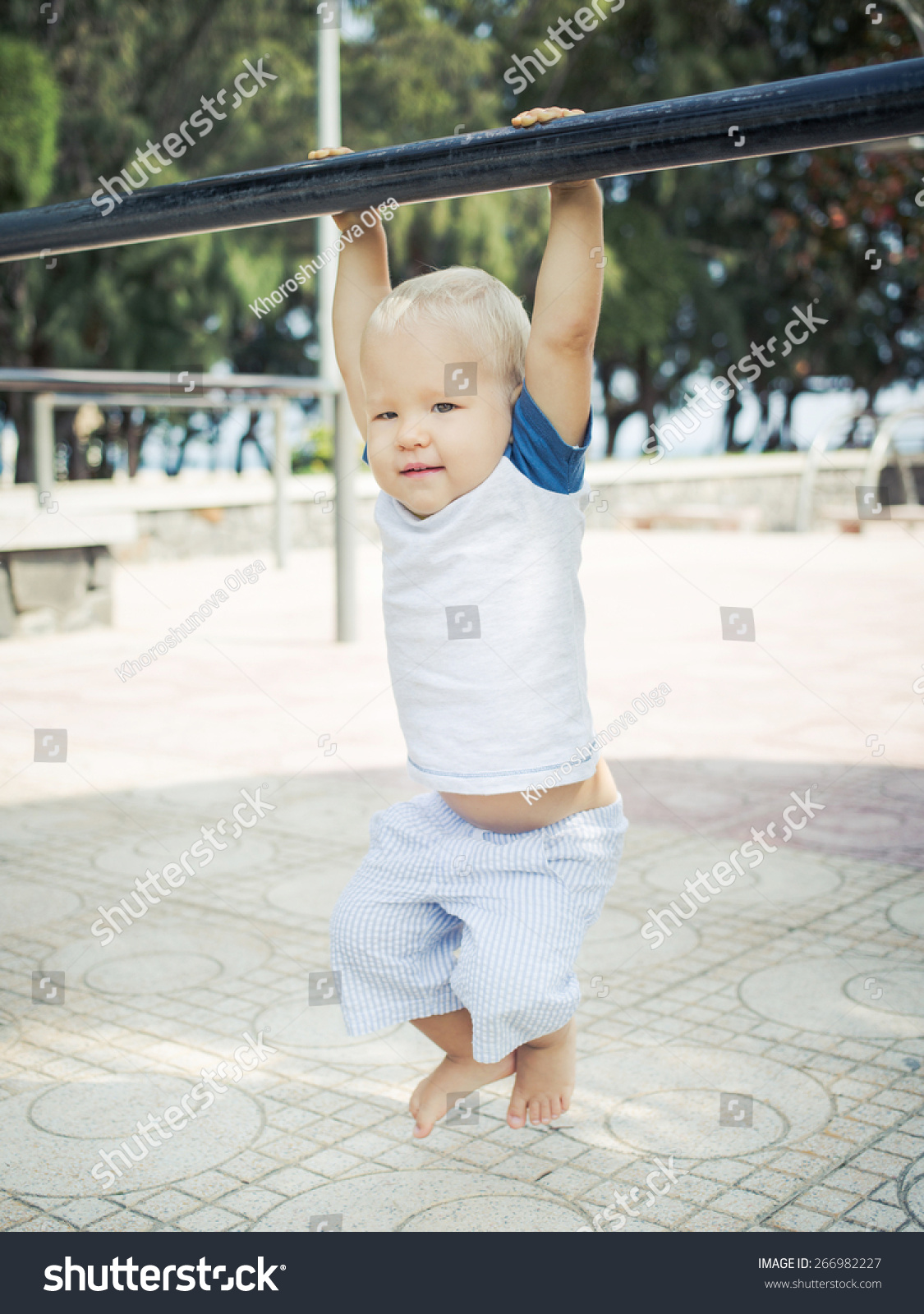 Baby Hanging On A Pull Up Bar Stock Photo 266982227