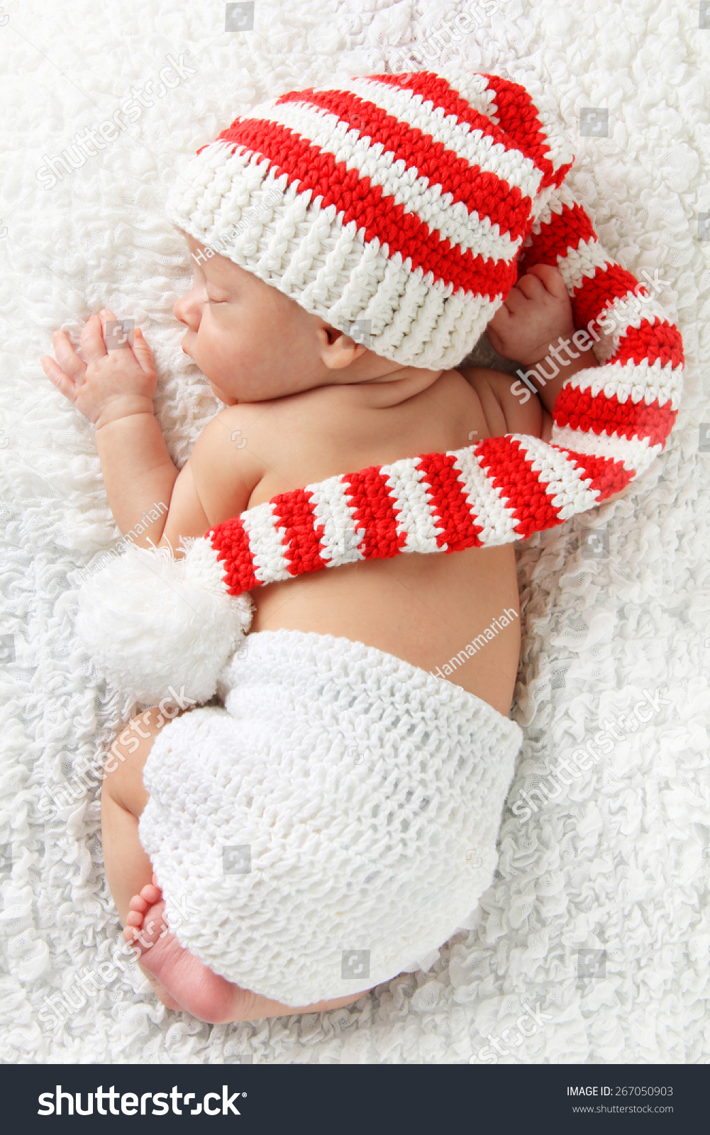 Knitting Pattern Newborn Elf Hat : Newborn Baby Wearing A Knitted Christmas Elf Hat. Stock ...