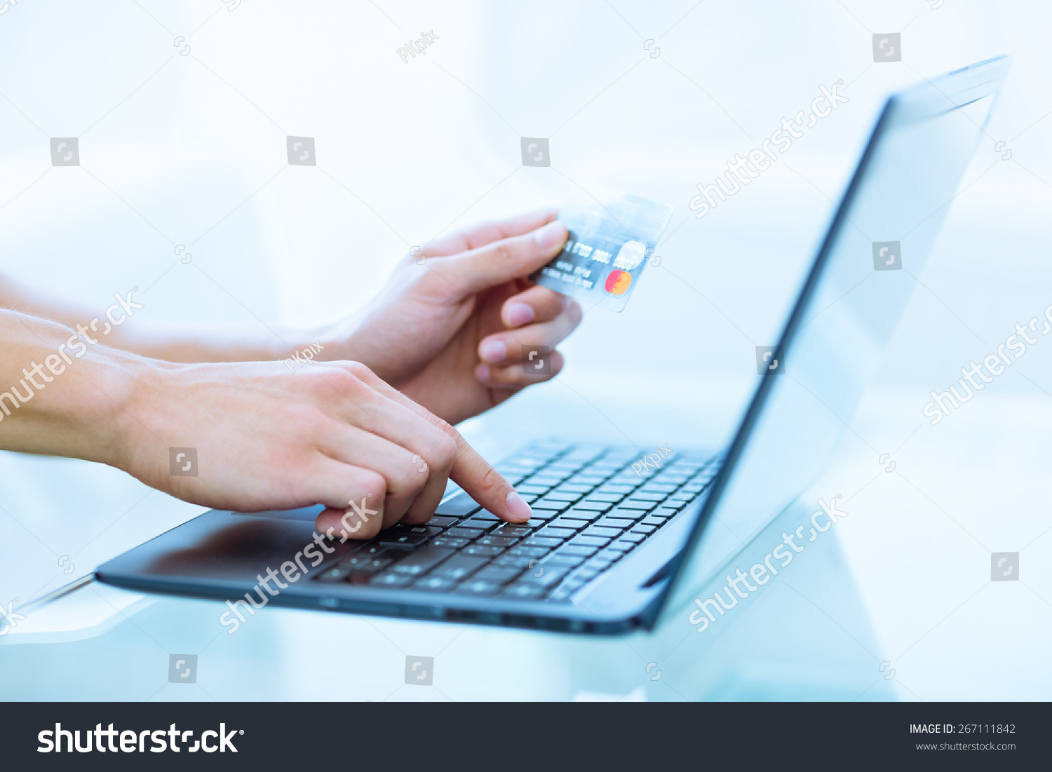 close up of hands shopping paying online using laptop and credit card stock photo 267111842. Black Bedroom Furniture Sets. Home Design Ideas