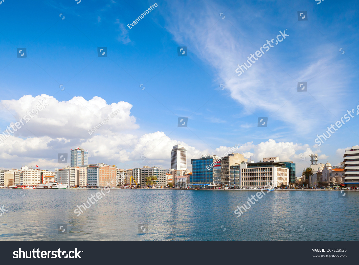 coastal cityscape with modern buildings under cloudy sky