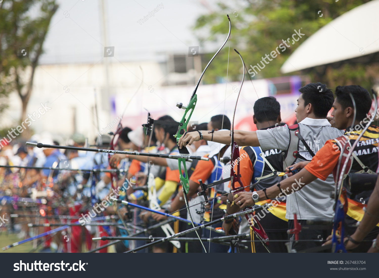 Bangkok Thailand March 15-22 2015 Unidentified archers in a row and shootin 2015 Asia Cup-World Ranking Tournament stage II at Hua Mak Sports Complex on March 18 2015 in Bangkok Thailand