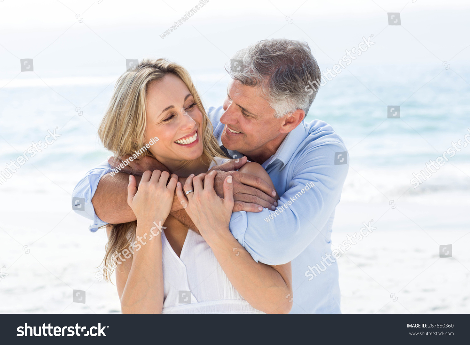 happy couple hugging each other by stock photo 267650360