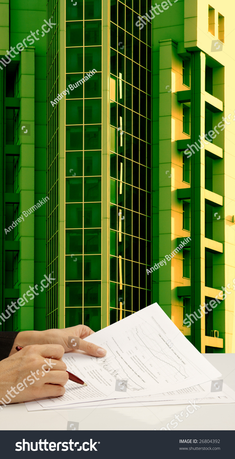 Technology Management Image: Realtor On Background Of Green Building Stock Photo