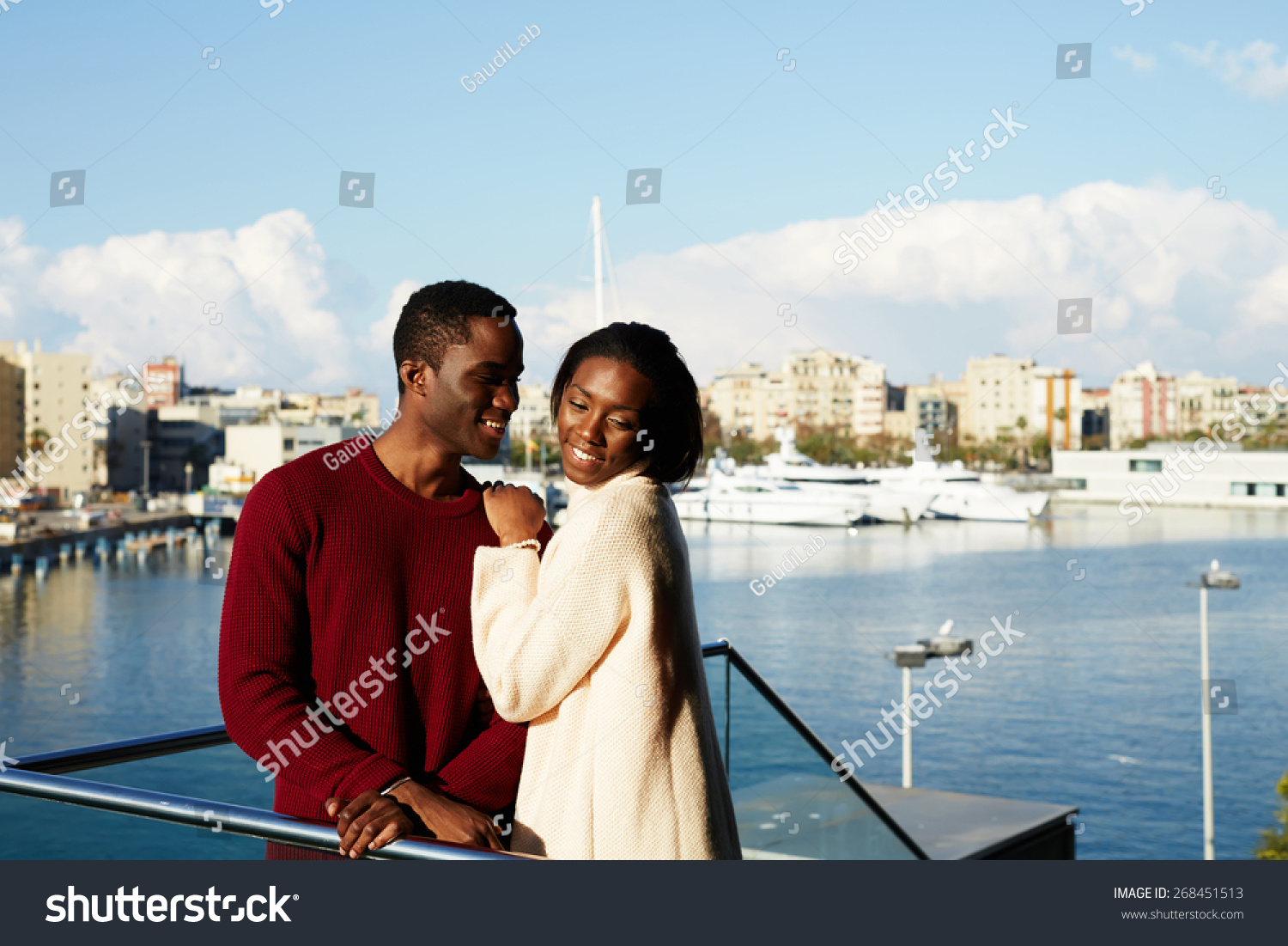 Portrait of happy hugging couple on modern balcony with for Other names for balcony