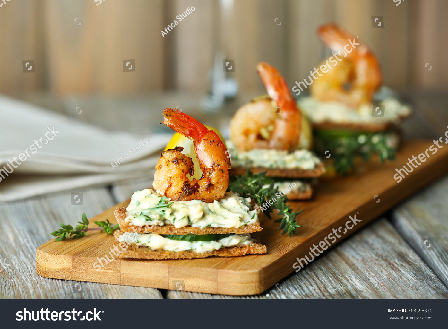 Appetizer canape with shrimp and cucumber on plate on for Appetizer canape