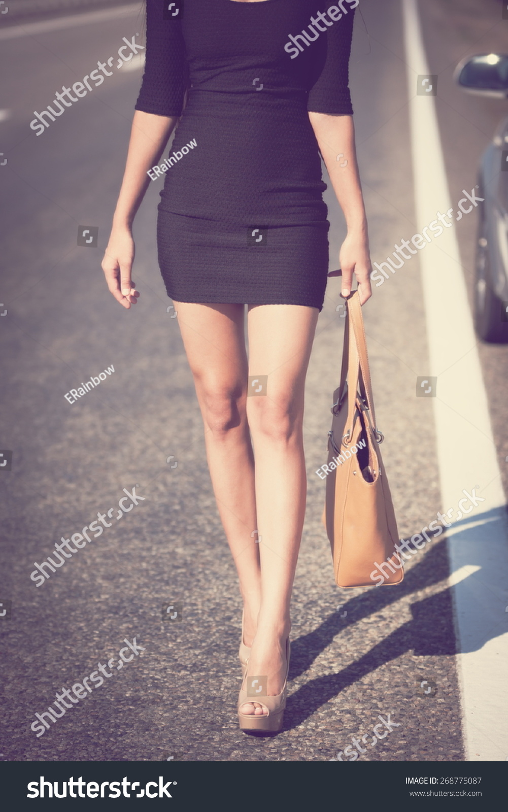 beautiful brunette sexy leg woman black stock photo (royalty free