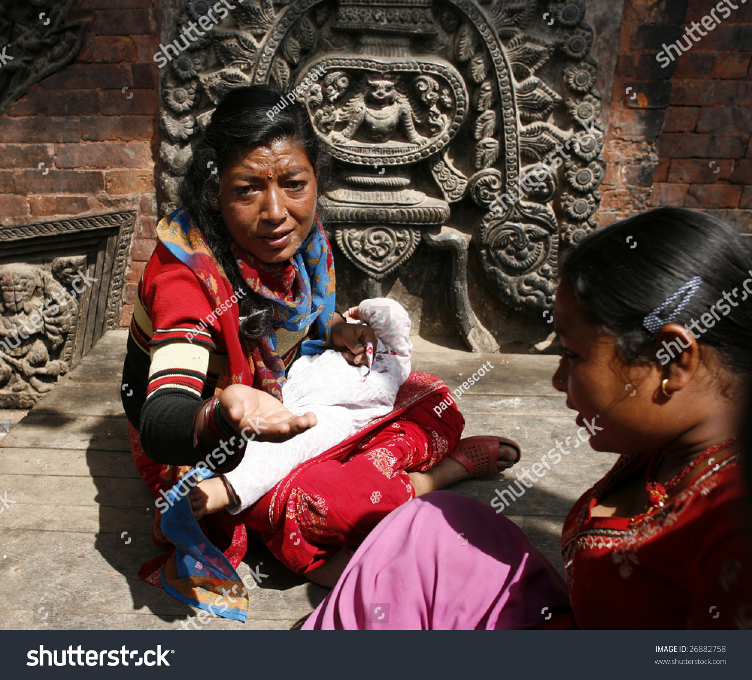 Latest Nepali Song Download On 320kbs: Bhaktapur, Nepal- April 13 : Local Woman Begs On The