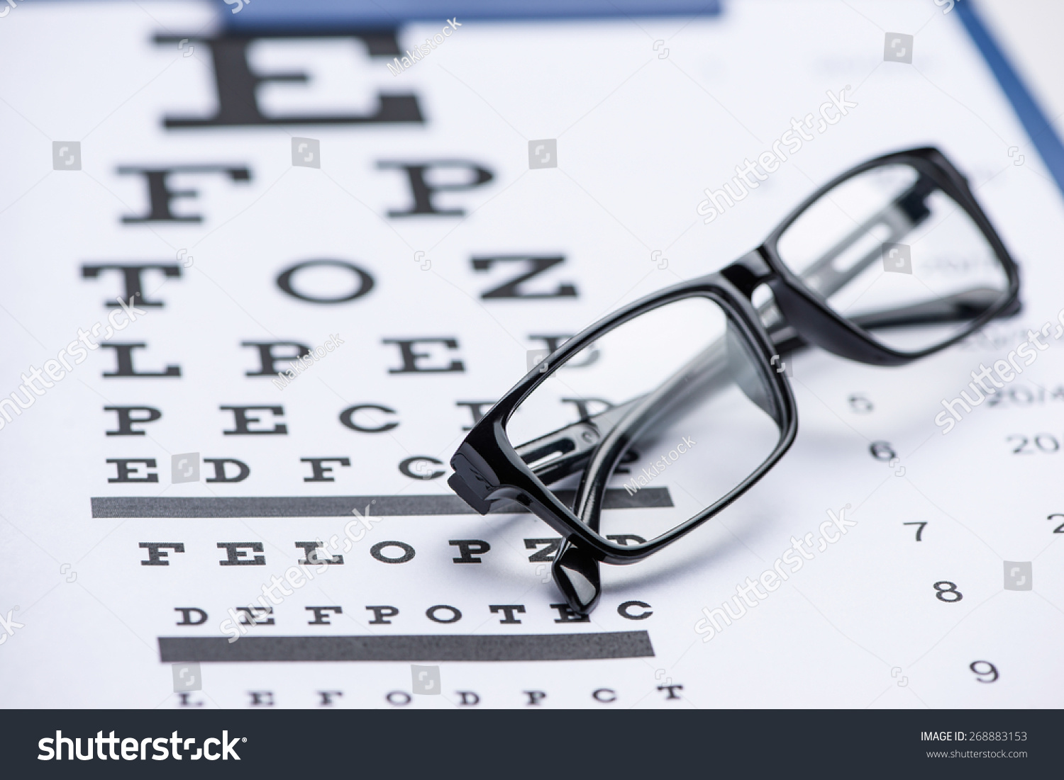 Reading glasses eye chart isolated on stock photo 268883153 reading glasses with eye chart isolated on white nvjuhfo Image collections