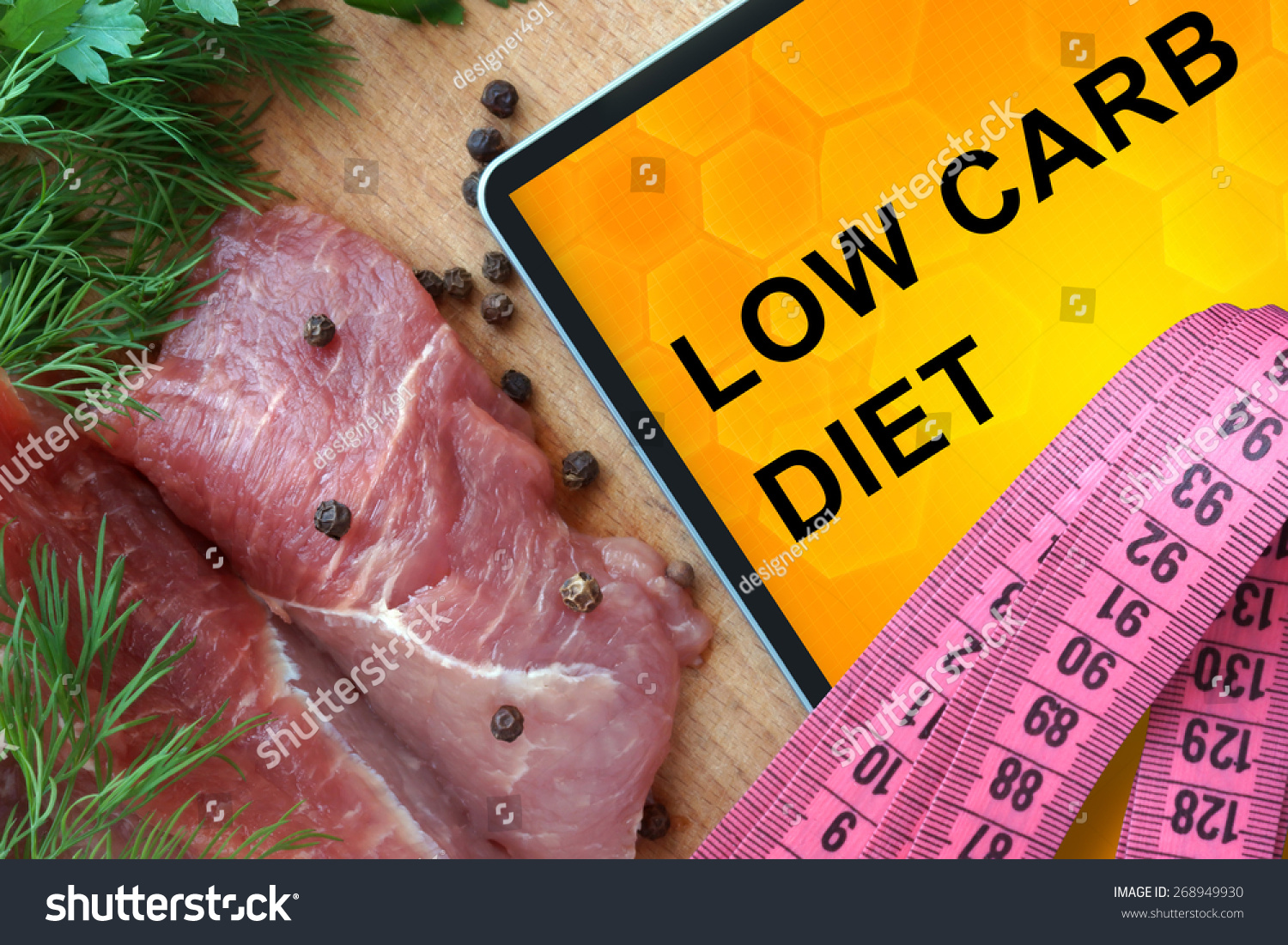 Tablet with low carb diet and fresh meat  on wooden board #268949930
