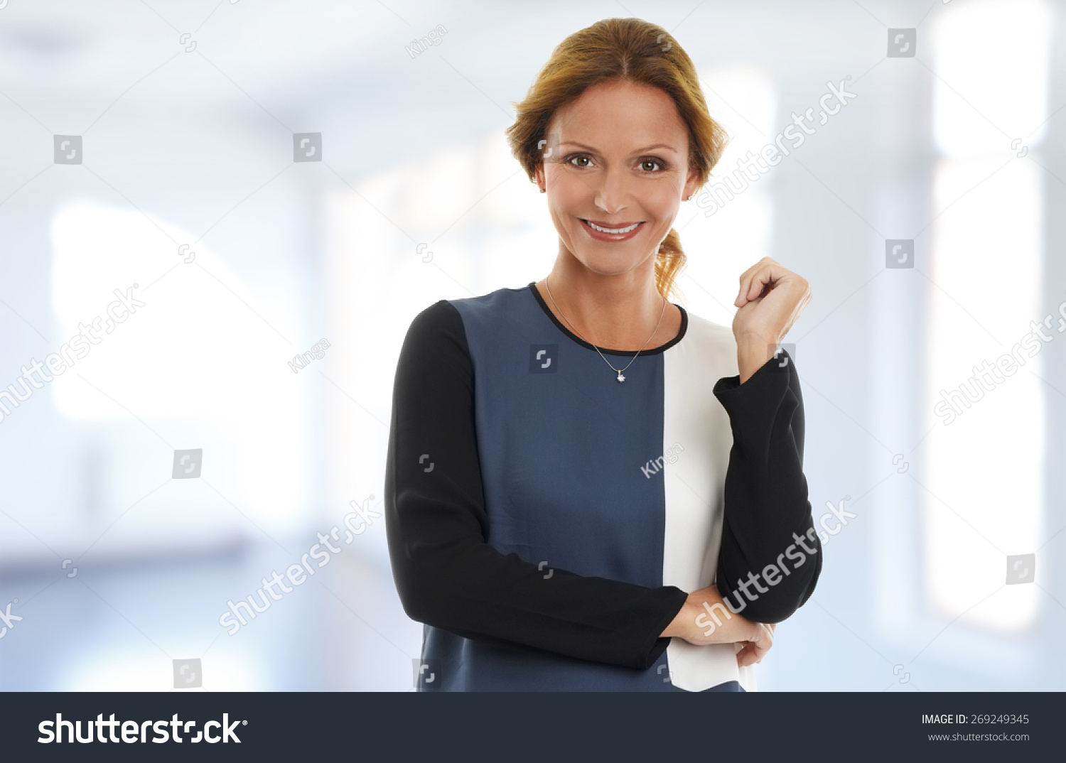 Portrait attractive businesswoman standing office while stock photo 269249345 shutterstock - Office portrait photography ...