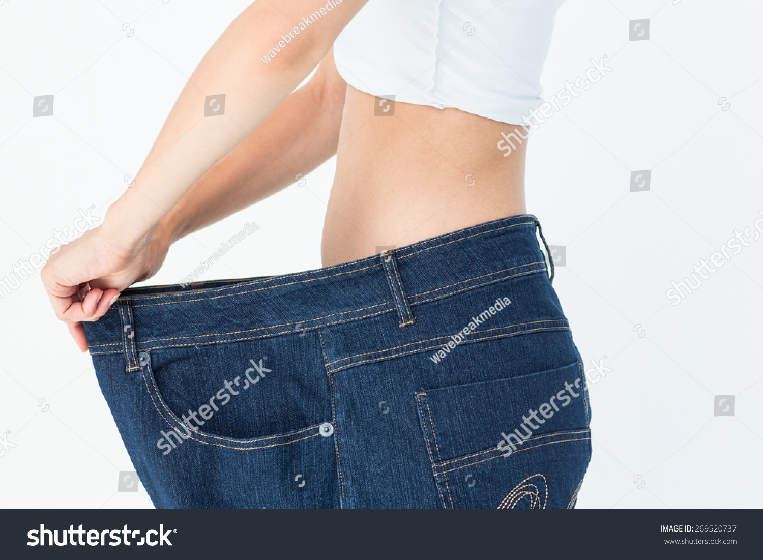 Background image too big - Woman Belly In Too Big Pants On White Background