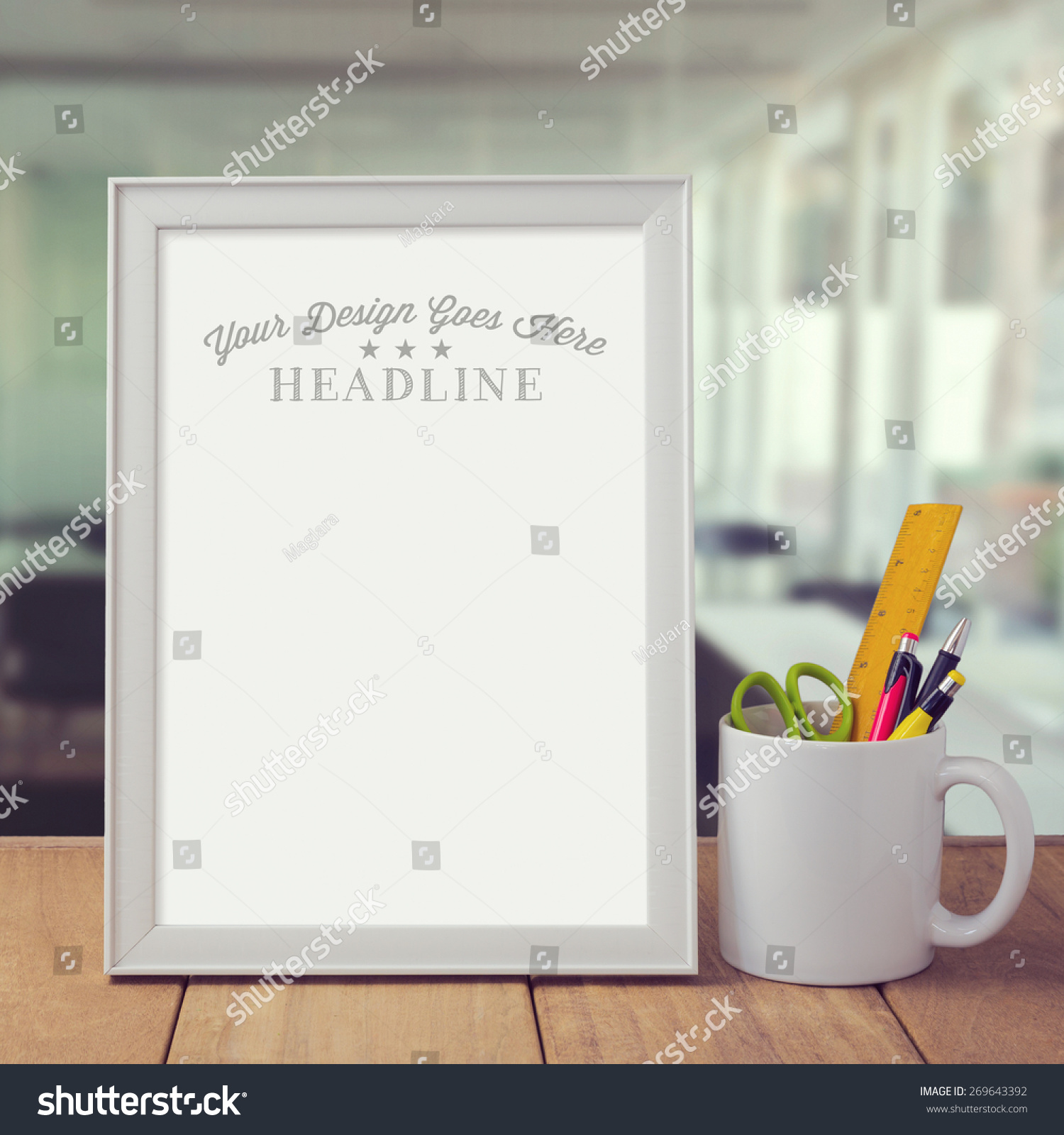 poster mock template over office background stock photo  poster mock up template over office background