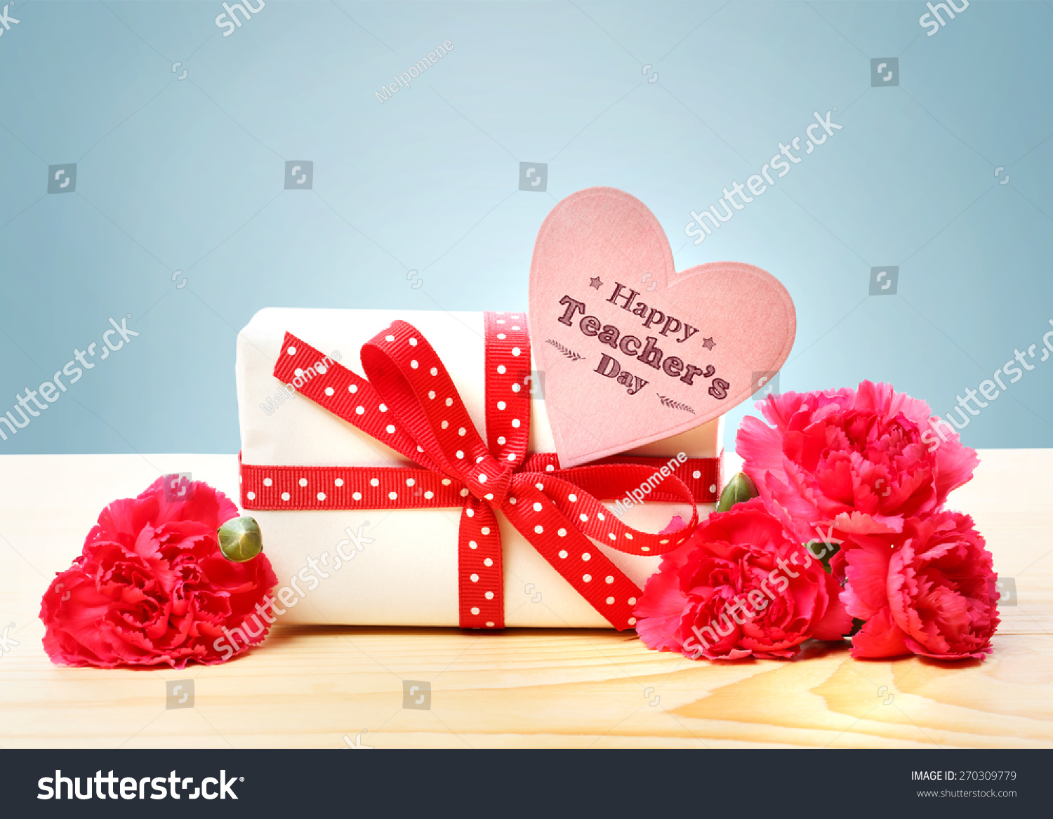 Happy teachers day message small gift stock photo 270309779 happy teachers day message with a small gift box and pink carnations kristyandbryce Image collections