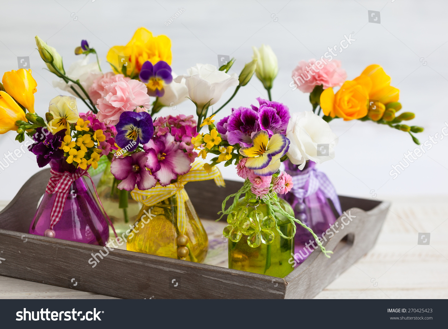 Beautiful Fresh Flowers In Glass Bottles On The Wooden Table Ez Canvas